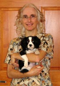 Pamela-Fisher-DVM holding small dog